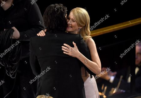 """Adam Driver, Laura Dern. Adam Driver, left, congratulates Laura Dern, winner of the award for best performance by an actress in a supporting role for """"Marriage Story"""" at the Oscars, at the Dolby Theatre in Los Angeles"""