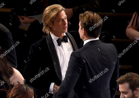 Brad Pitt, Bradley Cooper. Brad Pitt, left, and Bradley Cooper speak at the Oscars, at the Dolby Theatre in Los Angeles