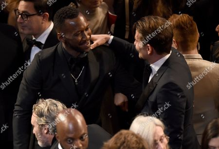 Mahershala Ali, Bradley Cooper. Mahershala Ali, left, and Bradley Cooper appear in the audience at the Oscars, at the Dolby Theatre in Los Angeles