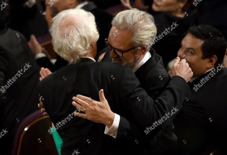 """Roger Deakins, Sam Mendes. Roger Deakins, left, is congratulated by Sam Mendes before going on stage to accept the award for best cinematography for """"1917"""" at the Oscars, at the Dolby Theatre in Los Angeles"""