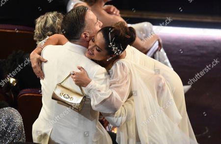 David Furnish, Salma Hayek. David Furnish, left, and Salma Hayek greet at the Oscars, at the Dolby Theatre in Los Angeles
