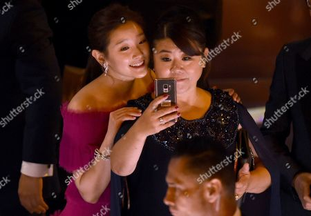 "Park So-dam, Lee Jeong-eun. Park So-dam, left, and Lee Jeong-eun take a selfie as they appear on stage to accept the award for best picture for ""Parasite"" at the Oscars, at the Dolby Theatre in Los Angeles"