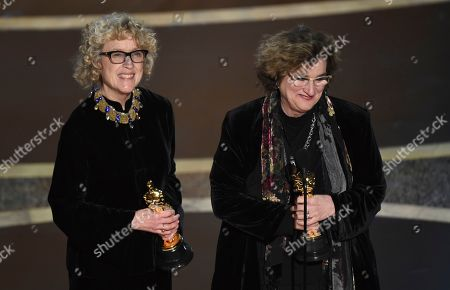 """Barbara Ling, Nancy Haigh. Nancy Haigh, left, and Barbara Ling accept the award for best production design for """"Once Upon a Time in Hollywood"""" at the Oscars, at the Dolby Theatre in Los Angeles"""