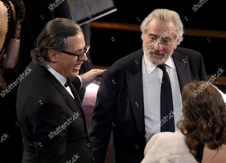 Rodrigo Prieto, Robert De Niro. Rodrigo Prieto, left, and Robert De Niro are seen in the audience before the start of the Oscars, at the Dolby Theatre in Los Angeles