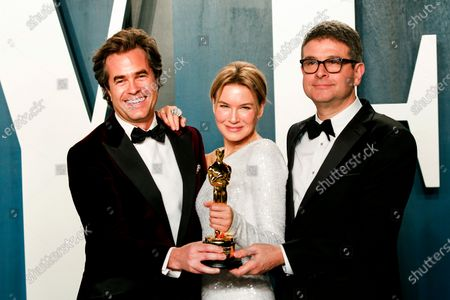 Rupert Goold, Renee Zellweger holding her Oscar trophy for Best Actress and Tom Edge attend the 2020 Vanity Fair Oscar Party following the 92nd annual Academy Awards ceremony, in Beverly Hills, California, USA, 09 February 2020. The Oscars were presented for outstanding individual or collective efforts in filmmaking in 24 categories.
