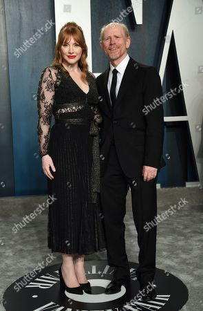 Bryce Dallas Howard, Ron Howard. Bryce Dallas Howard, left, and Ron Howard arrive at the Vanity Fair Oscar Party, in Beverly Hills, Calif