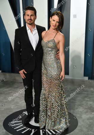 Stock Photo of Brad Wilk, Juliette Lewis. Brad Wilk, left, and Juliette Lewis arrive at the Vanity Fair Oscar Party, in Beverly Hills, Calif