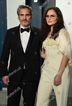 Joaquin Phoenix, Rain Phoenix. Joaquin Phoenix, left, and Rain Phoenix arrive at the Vanity Fair Oscar Party, in Beverly Hills, Calif