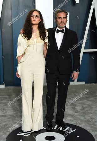 Joaquin Phoenix, Rain Phoenix. Joaquin Phoenix, right, and Rain Phoenix arrive at the Vanity Fair Oscar Party, in Beverly Hills, Calif
