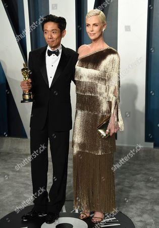 "Kazuhiro Tsuji, Charlize Theron. Kazuhiro Tsuji, winner of the award for best makeup and hairstyling for ""Darkest Hour,"" left, and Charlize Theron arrive at the Vanity Fair Oscar Party, in Beverly Hills, Calif"