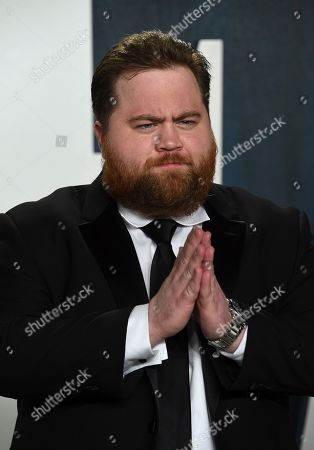 Stock Photo of Paul Walter Hauser arrives at the Vanity Fair Oscar Party, in Beverly Hills, Calif