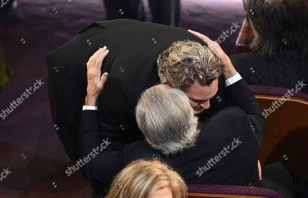 Joaquin Phoenix, Robert De Niro. Joaquin Phoenix, left, embraces Robert De Niro in the audience at the Oscars, at the Dolby Theatre in Los Angeles