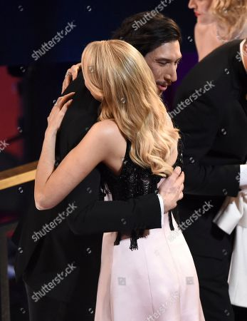 Laura Dern, Adam Driver. Adam Driver, left, embraces Laura Dern in the audience at the Oscars, at the Dolby Theatre in Los Angeles
