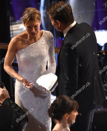 Renee Zellweger, Bradley Cooper. Renee Zellweger, left, and Bradley Cooper appear in the audience at the Oscars, at the Dolby Theatre in Los Angeles