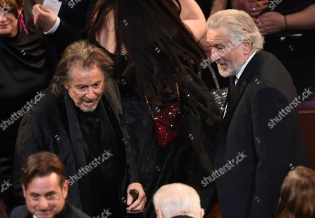 Al Pacino, Robert De Niro. Al Pacino, left, and Robert De Niro appear in the audience at the Oscars, at the Dolby Theatre in Los Angeles