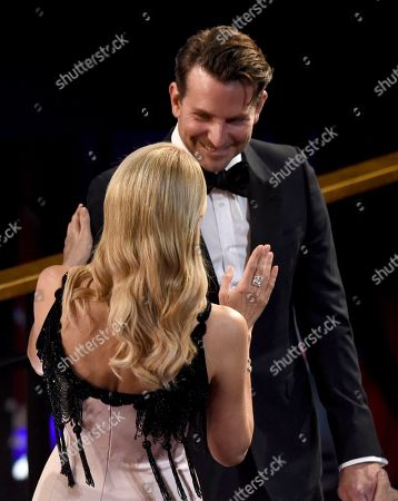 Laura Dern, Bradley Cooper. Laura Dern, left, greets Bradley Cooper in the audience at the Oscars, at the Dolby Theatre in Los Angeles