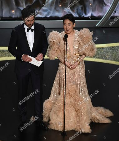 Ray Romano, Sandra Oh. Ray Romano, left, and Sandra Oh present the award for best makeup and hairstyling at the Oscars, at the Dolby Theatre in Los Angeles