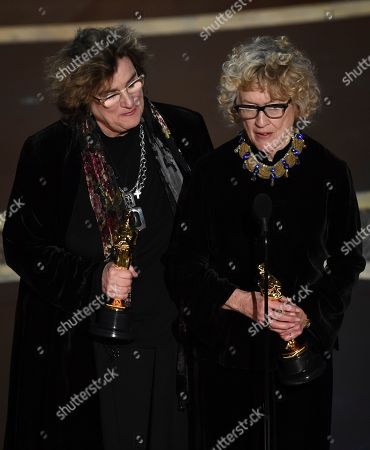 """Barbara Ling, Nancy Haigh. Barbara Ling, left, and Nancy Haigh accept the award for best production design for """"Once Upon a Time in Hollywood"""" at the Oscars, at the Dolby Theatre in Los Angeles"""