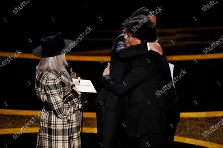 Bong Joon Ho (R) accepts his Oscar from Keanu Reeves (C) and Diane Keaton (L) after winning the Oscar for Best Original Screenplay for 'Parasite' during the 92nd annual Academy Awards ceremony at the Dolby Theatre in Hollywood, California, USA, 09 February 2020. The Oscars are presented for outstanding individual or collective efforts in filmmaking in 24 categories.
