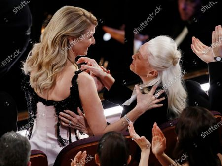 Laura Dern (L) reacts with her mother Diane Ladd (R) after winning the Oscar for Actress in a Supporting Role for 'Marriage Story' during the 92nd annual Academy Awards ceremony at the Dolby Theatre in Hollywood, California, USA, 09 February 2020. The Oscars are presented for outstanding individual or collective efforts in filmmaking in 24 categories.