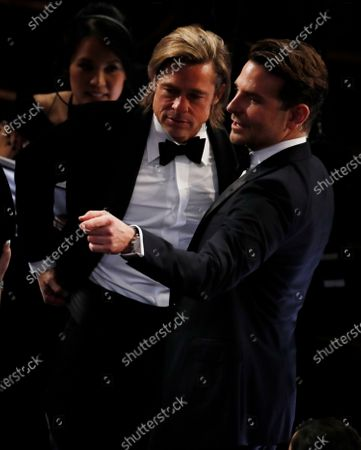 Brad Pitt (L) and Bradley Cooper (R) talk on the floor during a break during the 92nd annual Academy Awards ceremony at the Dolby Theatre in Hollywood, California, USA, 09 February 2020. The Oscars are presented for outstanding individual or collective efforts in filmmaking in 24 categories.