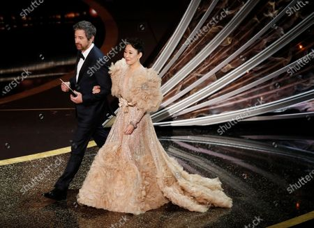 Ray Romano (L) and Sandra Oh arrive to present the Oscar for Achievement in Makeup and Hairstyling during the 92nd annual Academy Awards ceremony at the Dolby Theatre in Hollywood, California, USA, 09 February 2020. The Oscars are presented for outstanding individual or collective efforts in filmmaking in 24 categories.