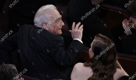 Martin Scorsese reacts as Bong Joon Ho acknowledges him as he accepts his Oscar for Achievement in Directing for 'Parasite' during the 92nd annual Academy Awards ceremony at the Dolby Theatre in Hollywood, California, USA, 09 February 2020. The Oscars are presented for outstanding individual or collective efforts in filmmaking in 24 categories.
