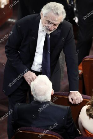 Robert De Niro (L) and US director Martin Scorsese interact during the 92nd annual Academy Awards ceremony at the Dolby Theatre in Hollywood, California, USA, 09 February 2020. The Oscars are presented for outstanding individual or collective efforts in filmmaking in 24 categories.