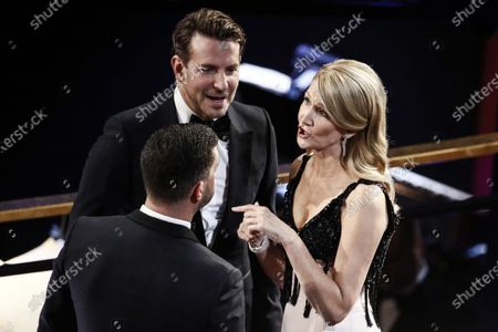 Stock Photo of Bradley Cooper (C) and Laura Dern (R) interact with a guest during the 92nd annual Academy Awards ceremony at the Dolby Theatre in Hollywood, California, USA, 09 February 2020. The Oscars are presented for outstanding individual or collective efforts in filmmaking in 24 categories.