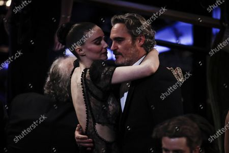 Joaquin Phoenix (R) holds in his arms US actress Rooney Mara during the 92nd annual Academy Awards ceremony at the Dolby Theatre in Hollywood, California, USA, 09 February 2020. The Oscars are presented for outstanding individual or collective efforts in filmmaking in 24 categories.