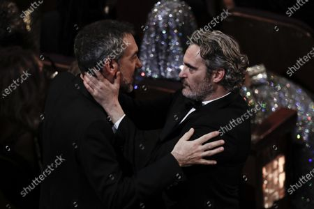 Joaquin Phoenix (R) interacts with US director Todd Phillips during the 92nd annual Academy Awards ceremony at the Dolby Theatre in Hollywood, California, USA, 09 February 2020. The Oscars are presented for outstanding individual or collective efforts in filmmaking in 24 categories.