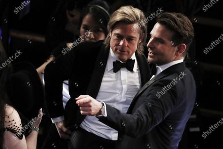 Brad Pitt (L) and Bradley Cooper interact during the 92nd annual Academy Awards ceremony at the Dolby Theatre in Hollywood, California, USA, 09 February 2020. The Oscars are presented for outstanding individual or collective efforts in filmmaking in 24 categories.