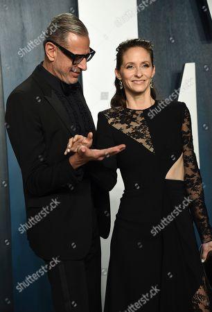 Jeff Goldblum, Emilie Livingston. Jeff Goldblum, left, and Emilie Livingston arrive at the Vanity Fair Oscar Party, in Beverly Hills, Calif