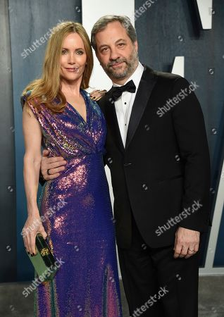 Leslie Mann, Judd Apatow. Leslie Mann, left and Judd Apatow arrives at the Vanity Fair Oscar Party, in Beverly Hills, Calif