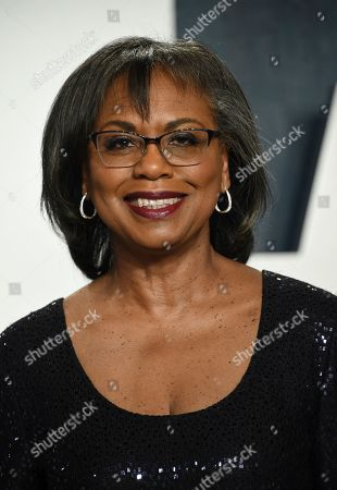 Anita Hill, right, arrives at the Vanity Fair Oscar Party, in Beverly Hills, Calif