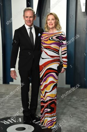 Bo Welch, Catherine O'Hara. Bo Welch, left, and Catherine O'Hara arrive at the Vanity Fair Oscar Party, in Beverly Hills, Calif