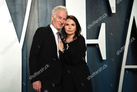 Stock Photo of John McEnroe, Patty Smyth. John McEnroe, left, and Patty Smyth arrive at the Vanity Fair Oscar Party, in Beverly Hills, Calif