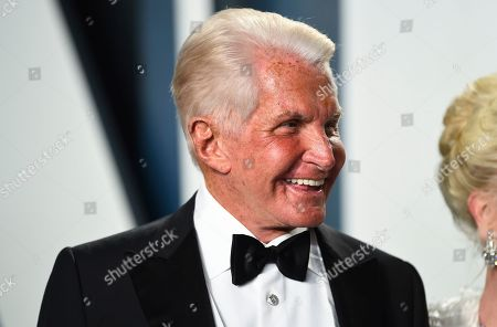 George Hamilton arrives at the Vanity Fair Oscar Party, in Beverly Hills, Calif