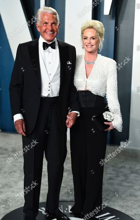 George Hamilton, Barbara Sturm. George Hamilton, left, and Barbara Sturm arrive at the Vanity Fair Oscar Party, in Beverly Hills, Calif
