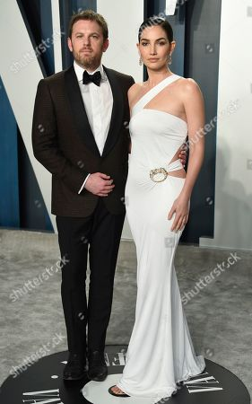 Stock Image of Caleb Followill, Lily Aldridge. Caleb Followill, left, and Lily Aldridge arrive at the Vanity Fair Oscar Party, in Beverly Hills, Calif