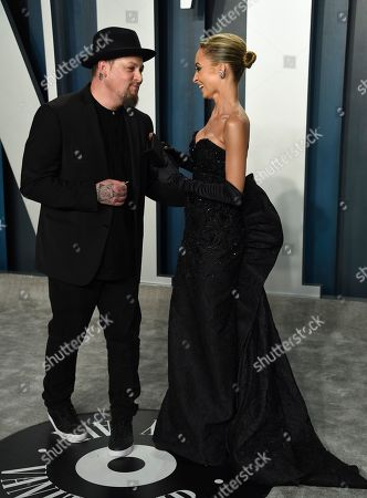 Joel Madden, Nicole Richie. Joel Madden, left, and Nicole Richie arrive at the Vanity Fair Oscar Party, in Beverly Hills, Calif