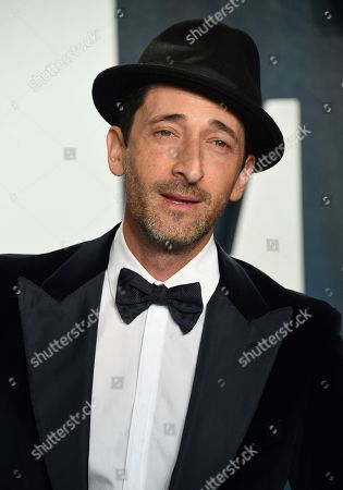 Adrien Brody arrives at the Vanity Fair Oscar Party, in Beverly Hills, Calif