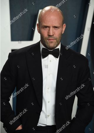 Jason Statham arrives at the Vanity Fair Oscar Party, in Beverly Hills, Calif