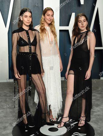 Danielle Haim, Este Haim, Alana Haim. Danielle Haim, from left, Este Haim and Alana Haim arrive at the Vanity Fair Oscar Party, in Beverly Hills, Calif
