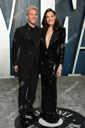 Gal Gadot, Yaron Varsano. Yaron Varsano, left and Gal Gadot arrive at the Vanity Fair Oscar Party, in Beverly Hills, Calif