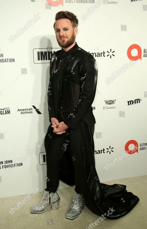 Bobby Berk arrives at the 2020 Sir Elton John AIDS Foundation Oscar Viewing Party, in West Hollywood, Calif