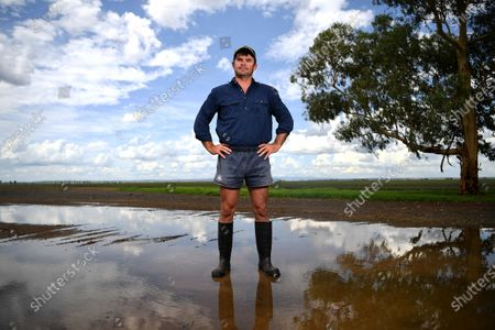 Stock Image of Farmer David Buckley poses for photos on his property near Dalby, Queensland, Australia, 10 February 2020. Buckley, who until recently was dealing with a long standing drought, had a significant amount of rain saturating his land in the last few days.