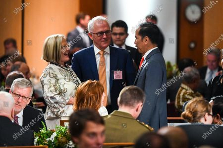 Stock Photo of Former Australian Prime Minister Malcolm Turnbull (C) and his wife Lucy (C-L) greet  Indonesian President Joko Widodo (C-R) as they attend an official luncheon in the Great Hall at Parliament House in Canberra, Australia, 10 February 2020. Widodo is on an official two-day visit to Canberra.
