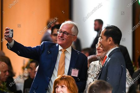Former Australian Prime Minister Malcolm Turnbull (L) and his wife Lucy (C-R, back) pose for a photo with Indonesian President Joko Widodo (R) as they attend an official luncheon in the Great Hall at Parliament House in Canberra, Australia, 10 February 2020. Widodo is on an official two-day visit to Canberra.