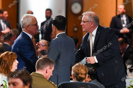 Former Australian Prime Minister Malcolm Turnbull (L), Indonesian President Joko Widodo (C) and Australian Prime Minister Scott Morrison (R) speak during an official luncheon in the Great Hall at Parliament House in Canberra, Australia, 10 February 2020. Widodo is on an official two-day visit to Canberra.